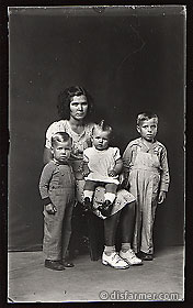 Woman with Three Children, One on Her Lap