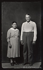 Older Couple, Man with Suspenders