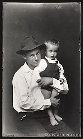 Boy in Fedora Holding Younger Brother