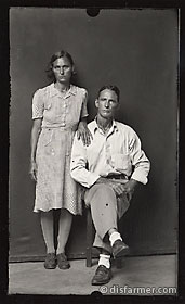 Man Seated with Wife in Polka Dot Dress