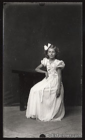 Girl Seated in White Dress