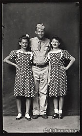 Soldier with Two Girls in Polka Dot Dresses
