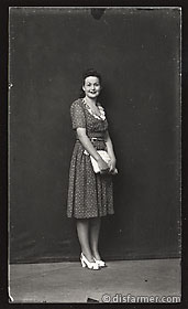 Woman in Polka Dot Dress with White Purse