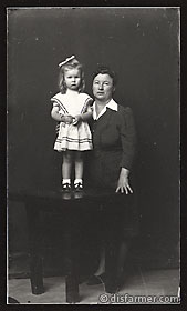 Woman in Black with Daughter Standing on Platform