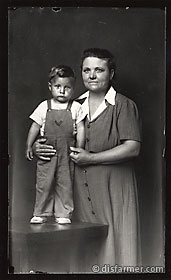 Woman in Grey Dress with Son on Platform