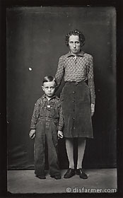 Mother Standing with Son in Overalls